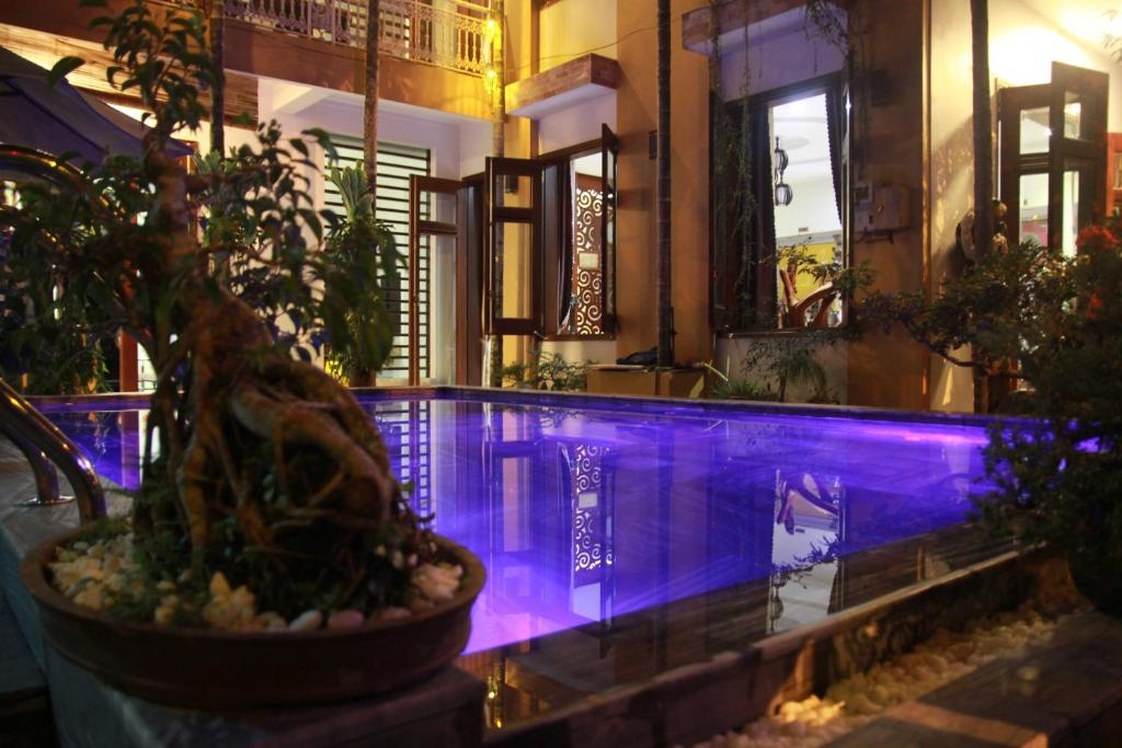 The swimming pool at or close to Hoi An Golden Horse Villa