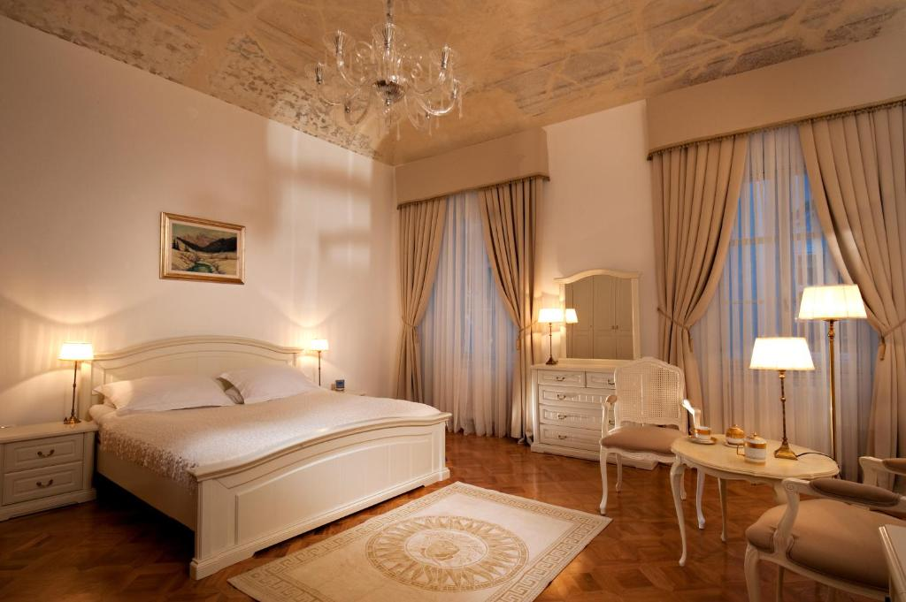 A bed or beds in a room at Antiq Palace - Small Luxury Hotels Of The World