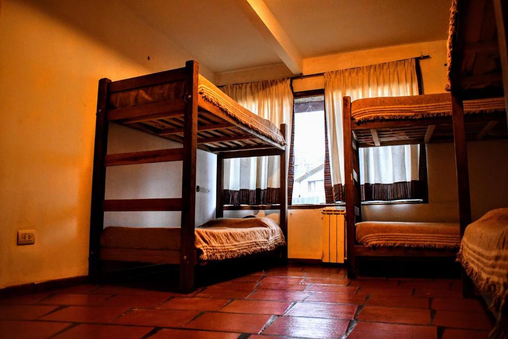 A bunk bed or bunk beds in a room at Rancho Aparte Refugio de Montaña
