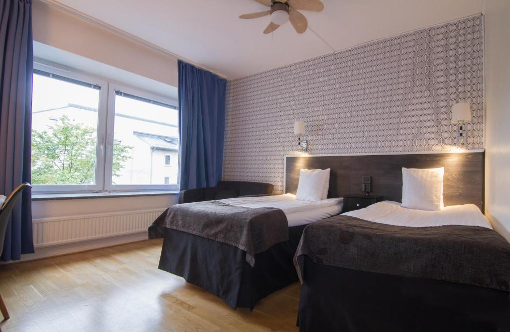 A bed or beds in a room at Sure Hotel by Best Western Stanga