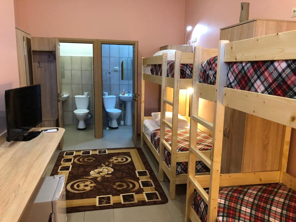 Двухъярусная кровать или двухъярусные кровати в номере Жемчужина Балтики