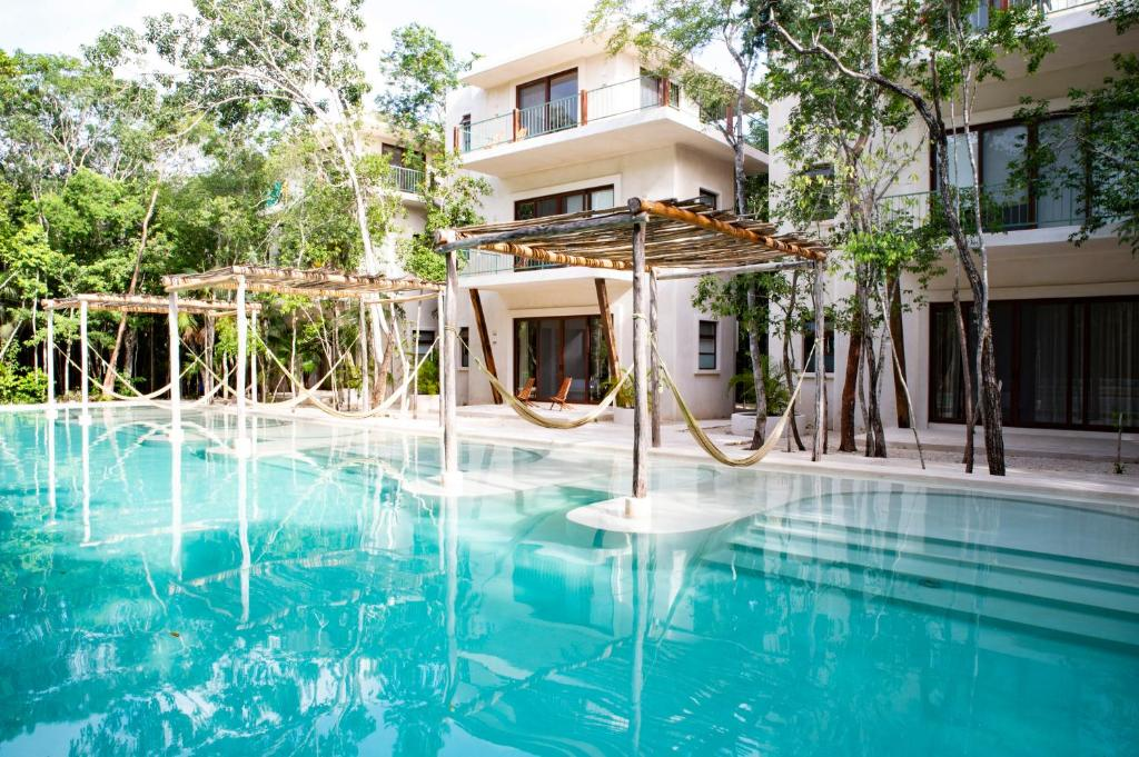 The swimming pool at or near Hotel Holistika Tulum