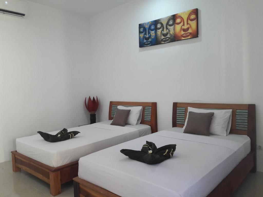 A bed or beds in a room at Chika House 2