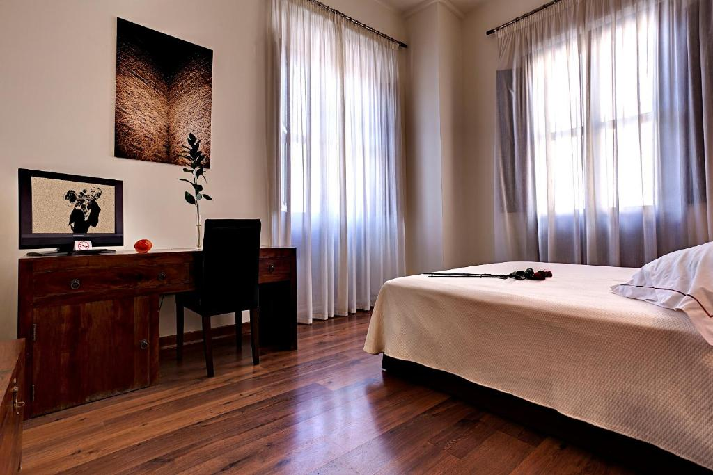 A bed or beds in a room at Casa del Trigo