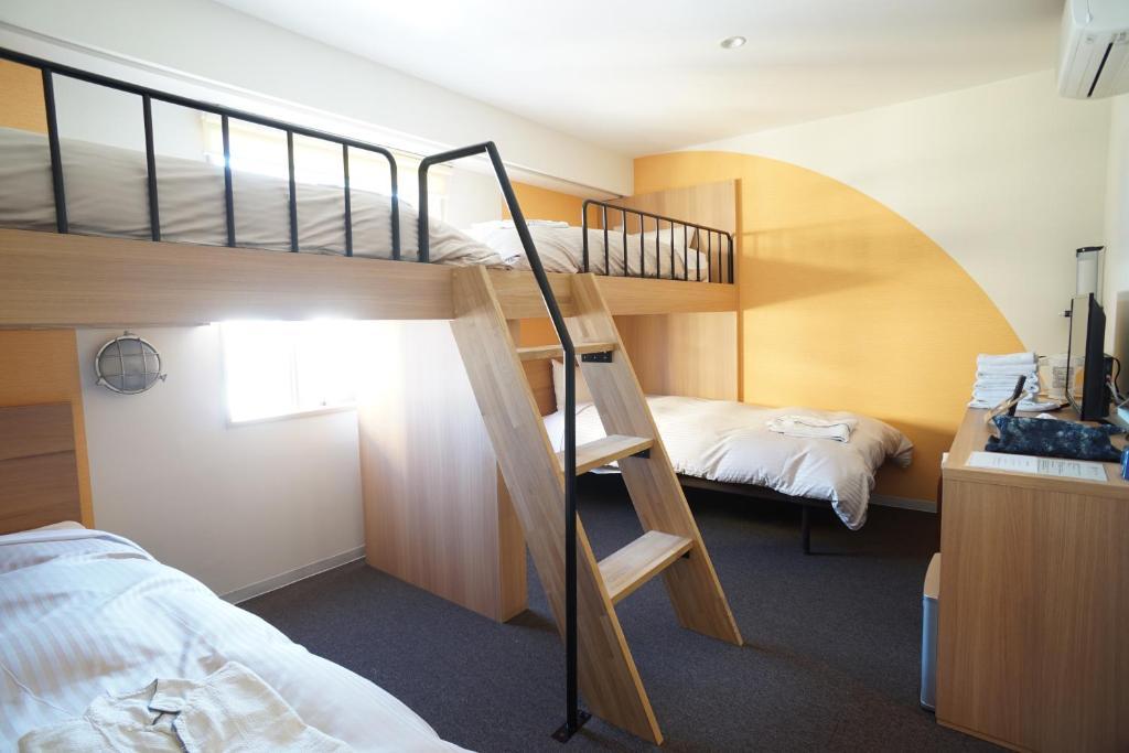 Litera o literas de una habitación en Toyron's Hotel Chitose