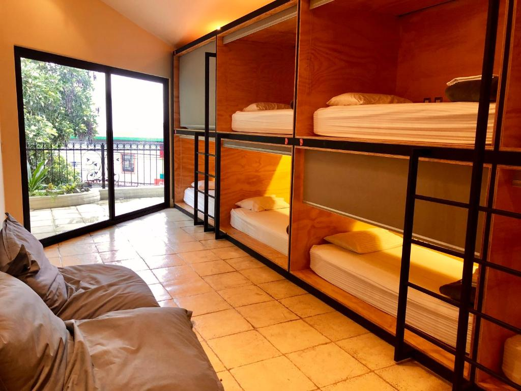 A bunk bed or bunk beds in a room at Fauna Luxury Hostel