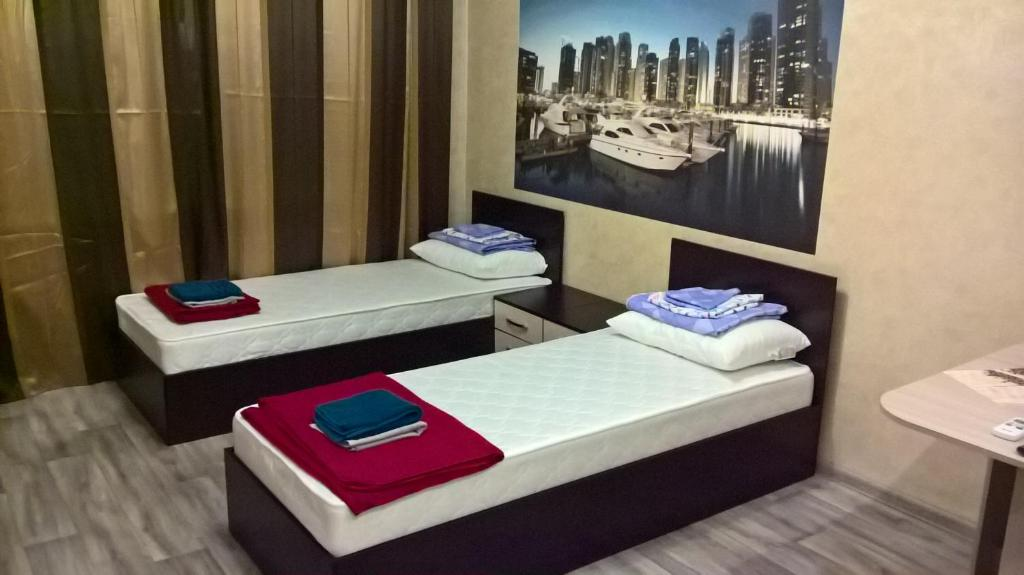 A bed or beds in a room at Mini-Hotel on Ostrovskogo 9