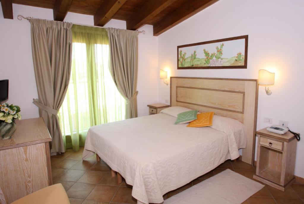 Cama ou camas em um quarto em Hotel La Borgata