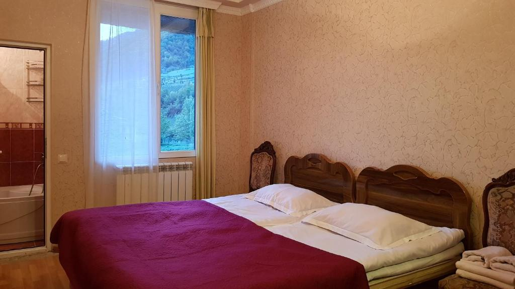 A bed or beds in a room at Hilltop Mestia