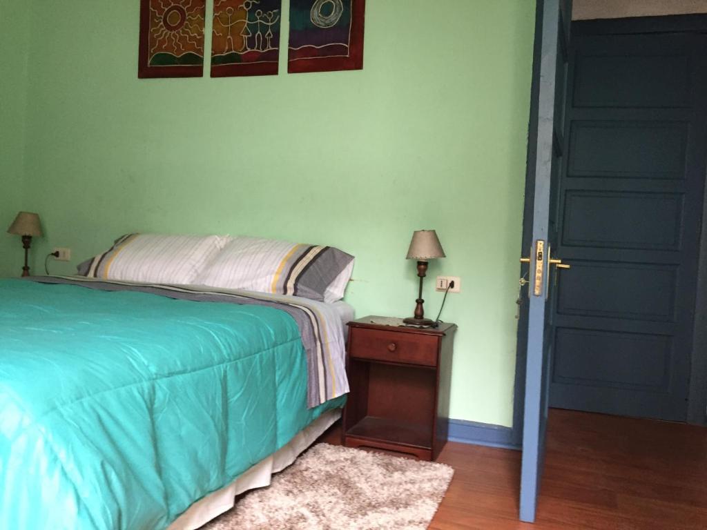 Cama o camas de una habitación en Casa conferencia
