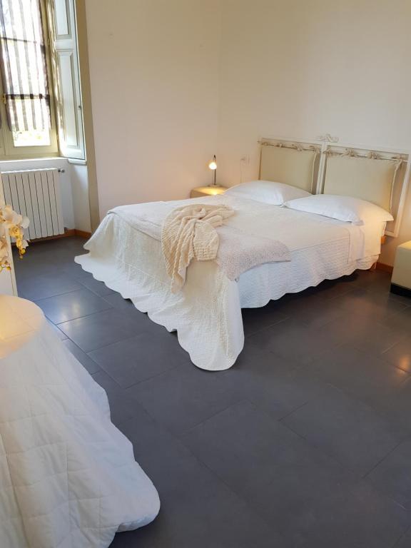 Letto o letti in una camera di CharmeRooms Villa Moroni
