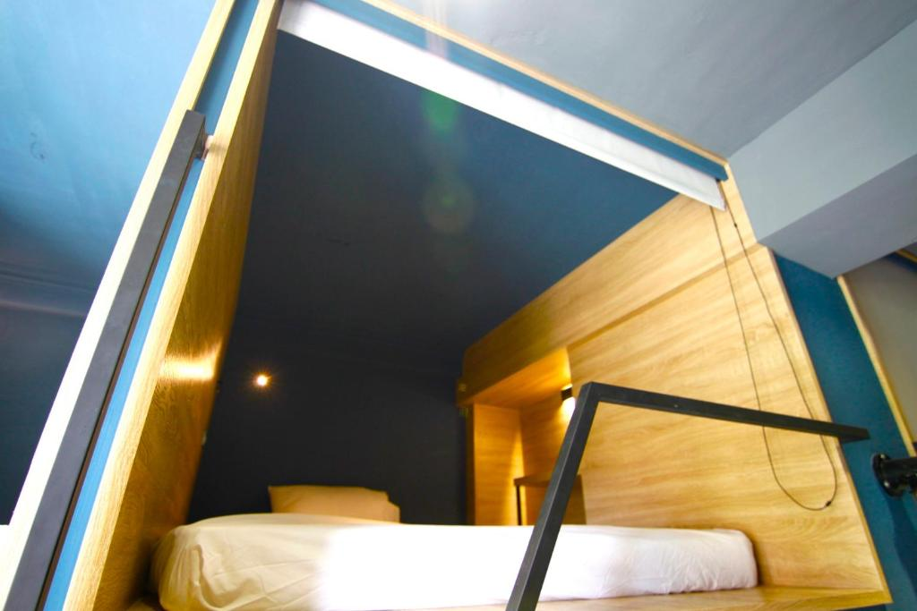 A bed or beds in a room at Dongmen 3 Capsule Inn