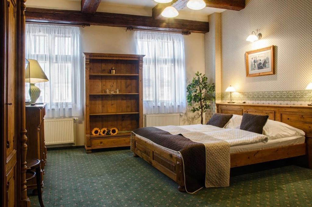 Postel nebo postele na pokoji v ubytování Hotel & Caffe Silesia