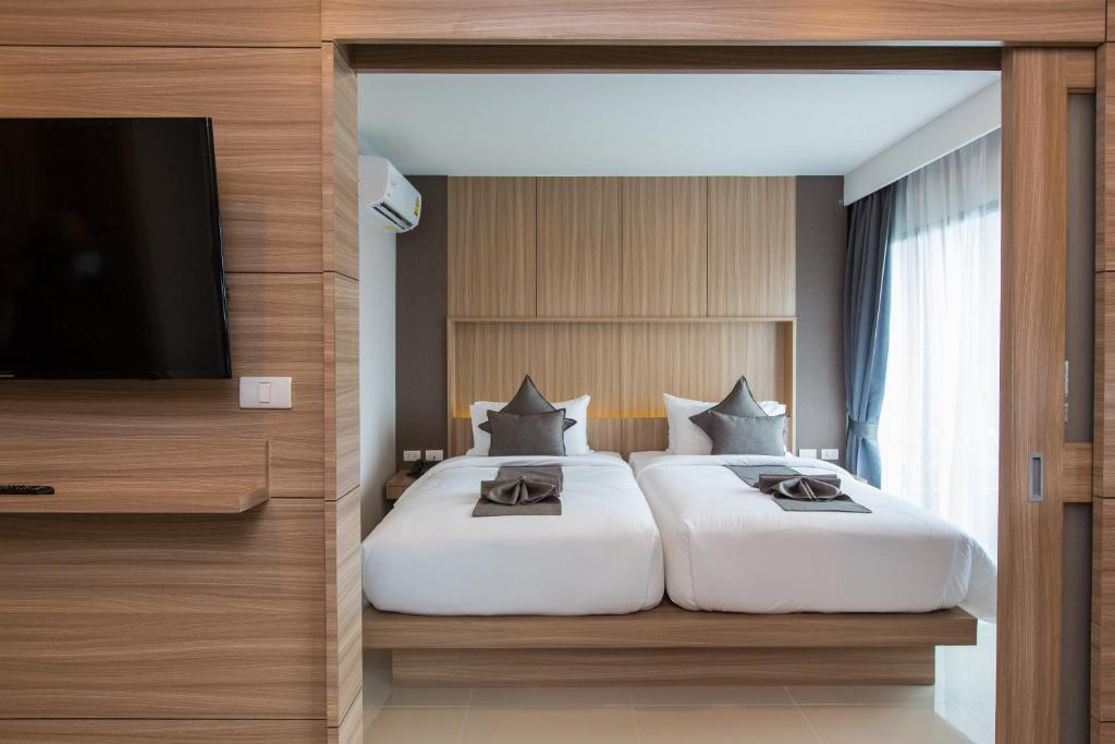 A bed or beds in a room at The Bay Exclusive Hotel
