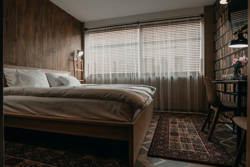 A bed or beds in a room at Aquapark Design Rooms