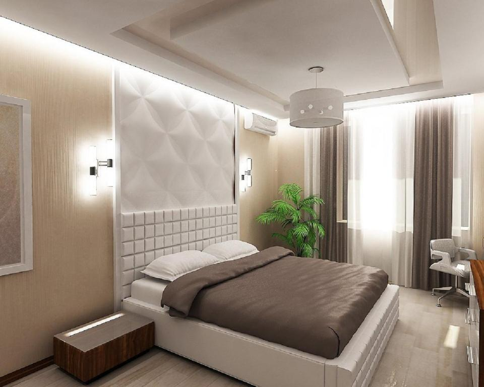 A bed or beds in a room at Studiominsk Apartments