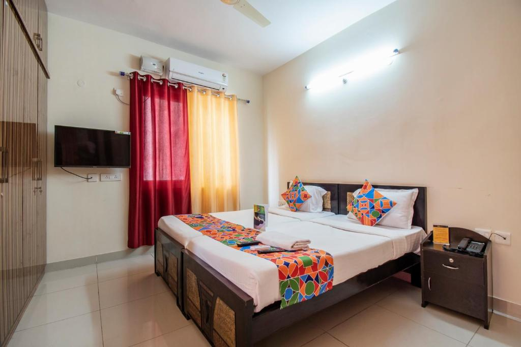 A bed or beds in a room at FabHotel Prime HiTech City