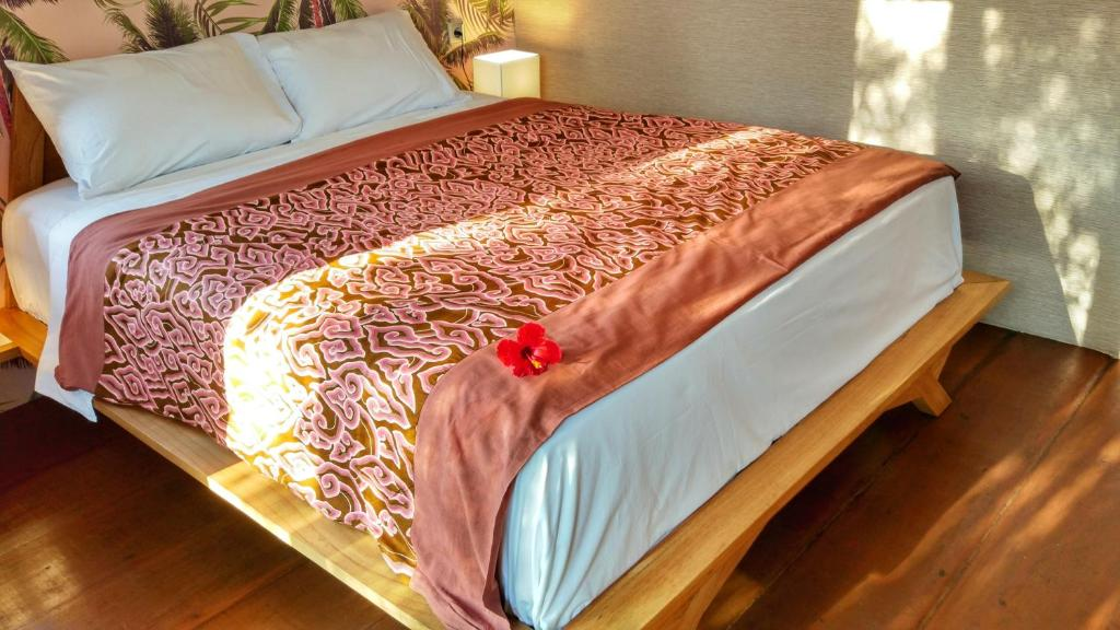 A bed or beds in a room at Petit Tree