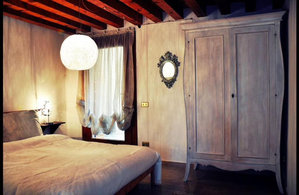 A bed or beds in a room at Relais nel Castello
