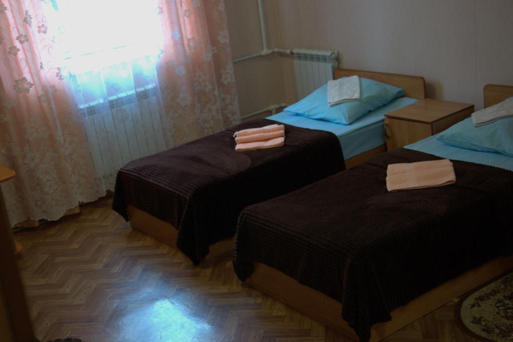 Кровать или кровати в номере Hotel Tambovskoy19