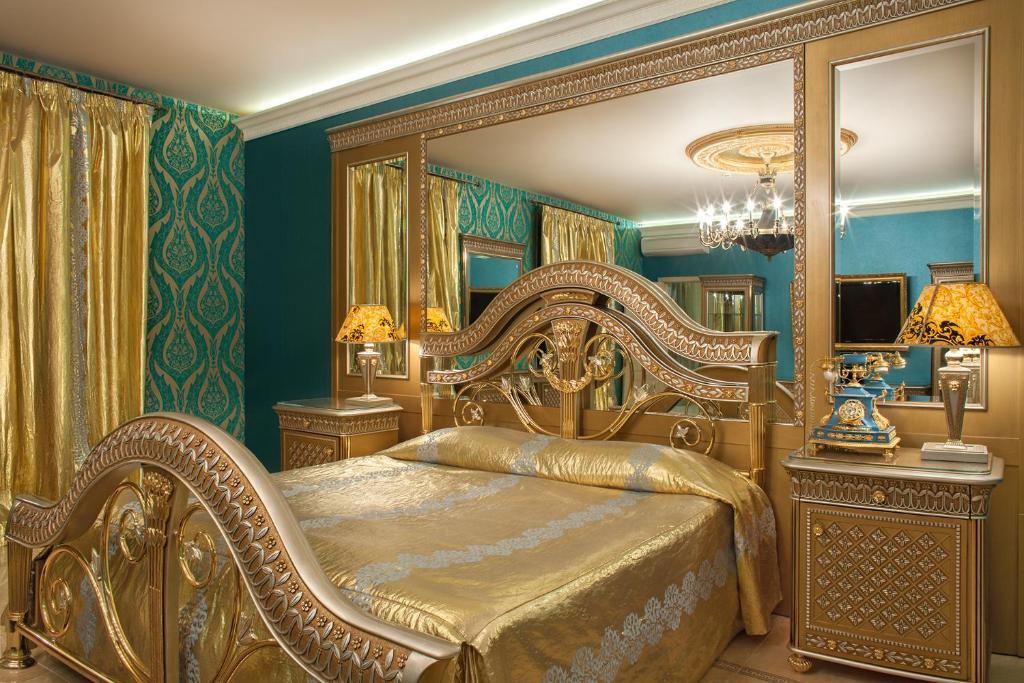 Кровать или кровати в номере Брестоль Отель