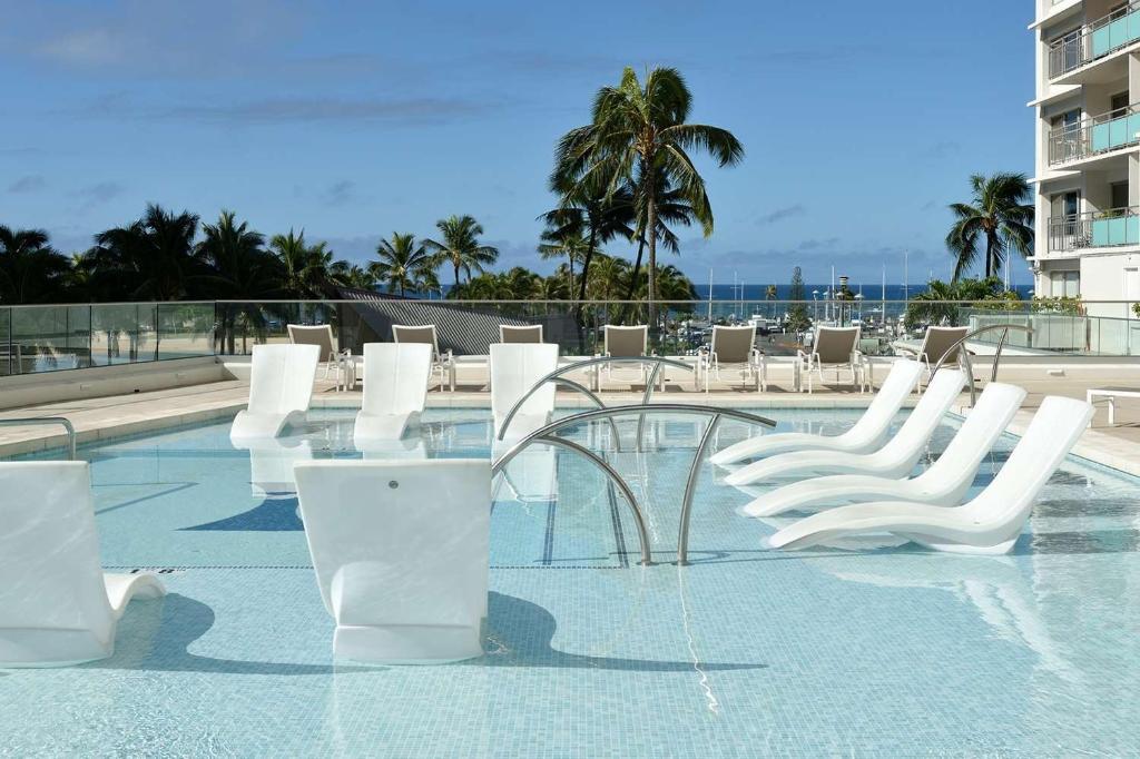 The swimming pool at or near Ilikai Hotel & Luxury Suites