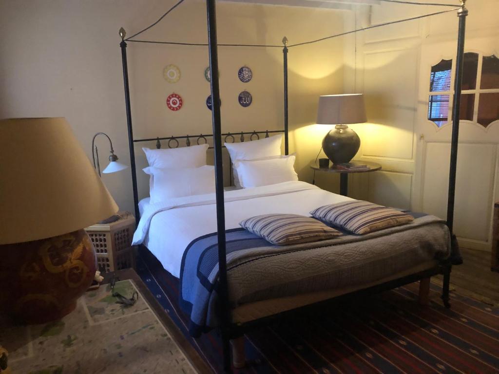 Кровать или кровати в номере Studio Rempart