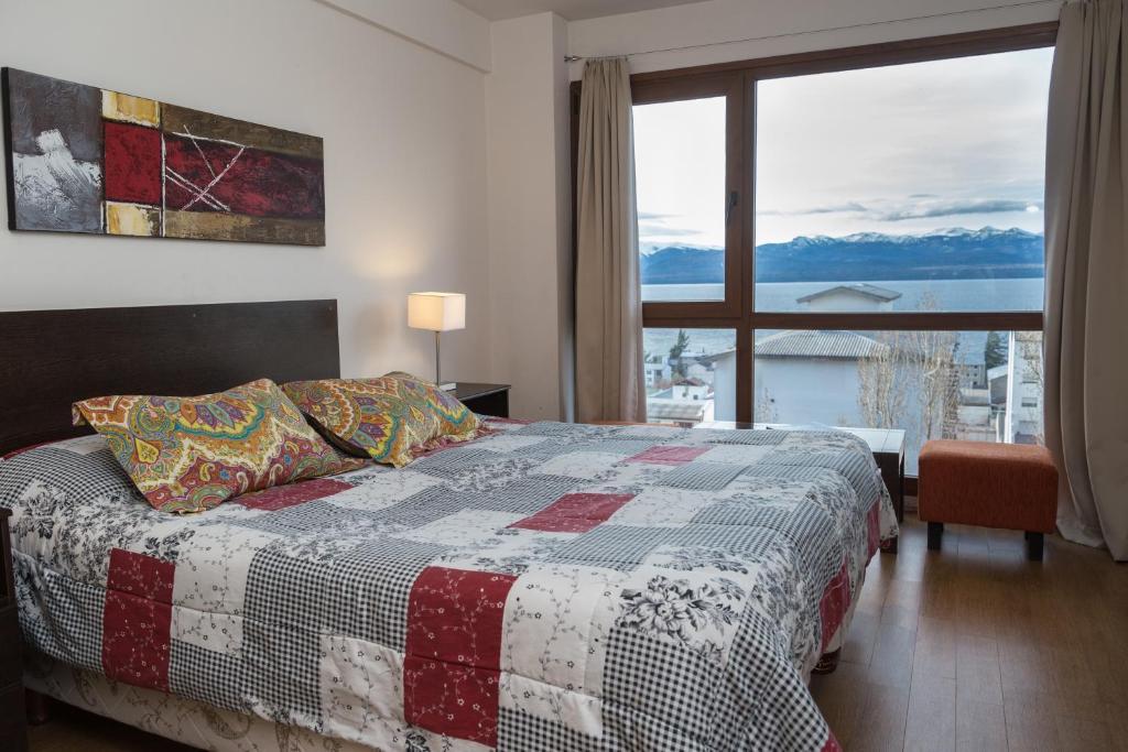 Una cama o camas en una habitación de Terrazas Apartment