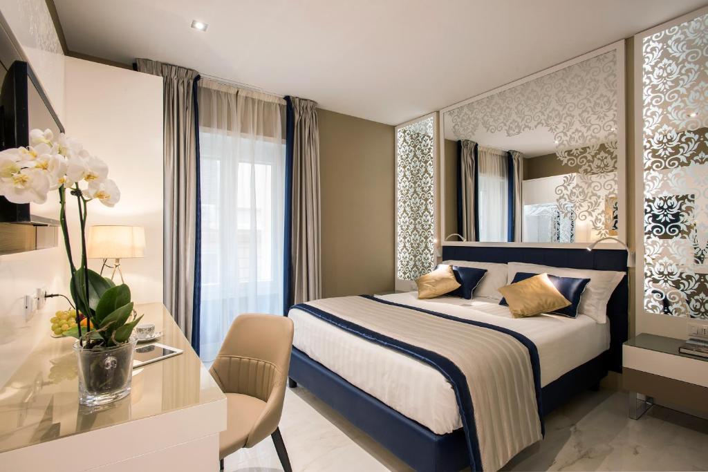 سرير أو أسرّة في غرفة في Residenza Venti Settembre
