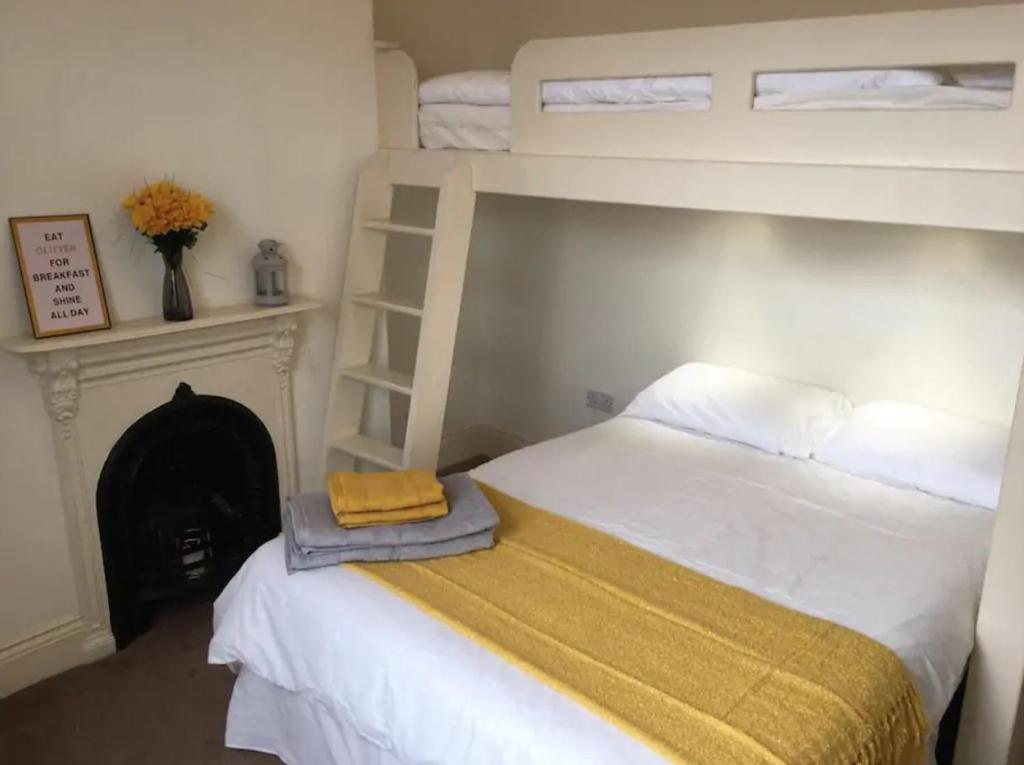 A bunk bed or bunk beds in a room at The Leeman Rose Hotel