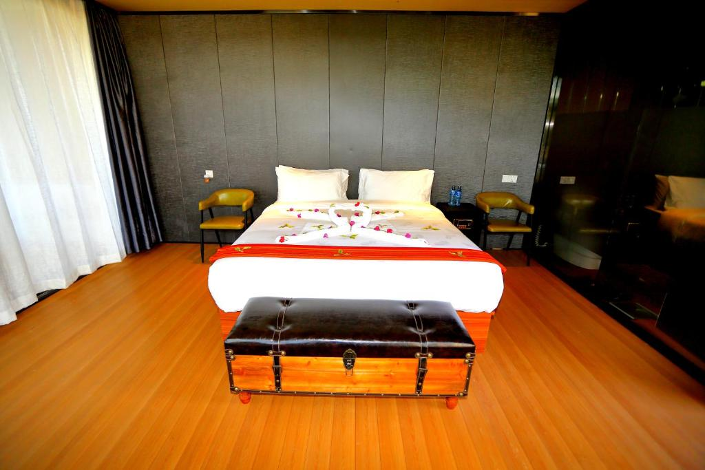 A bed or beds in a room at Jambo Mara Safari Lodge