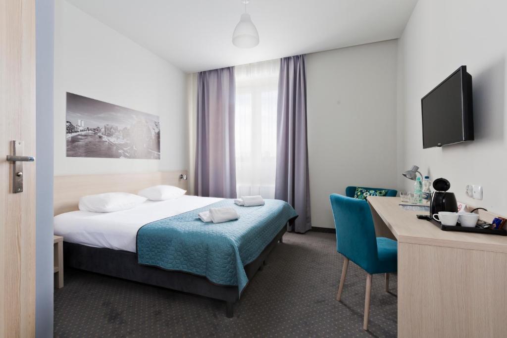 Łóżko lub łóżka w pokoju w obiekcie Hotel Silver
