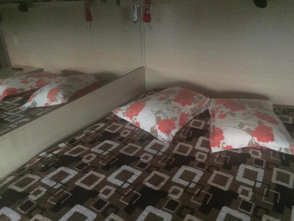 A bed or beds in a room at Aconchegante quarto com ótima vista