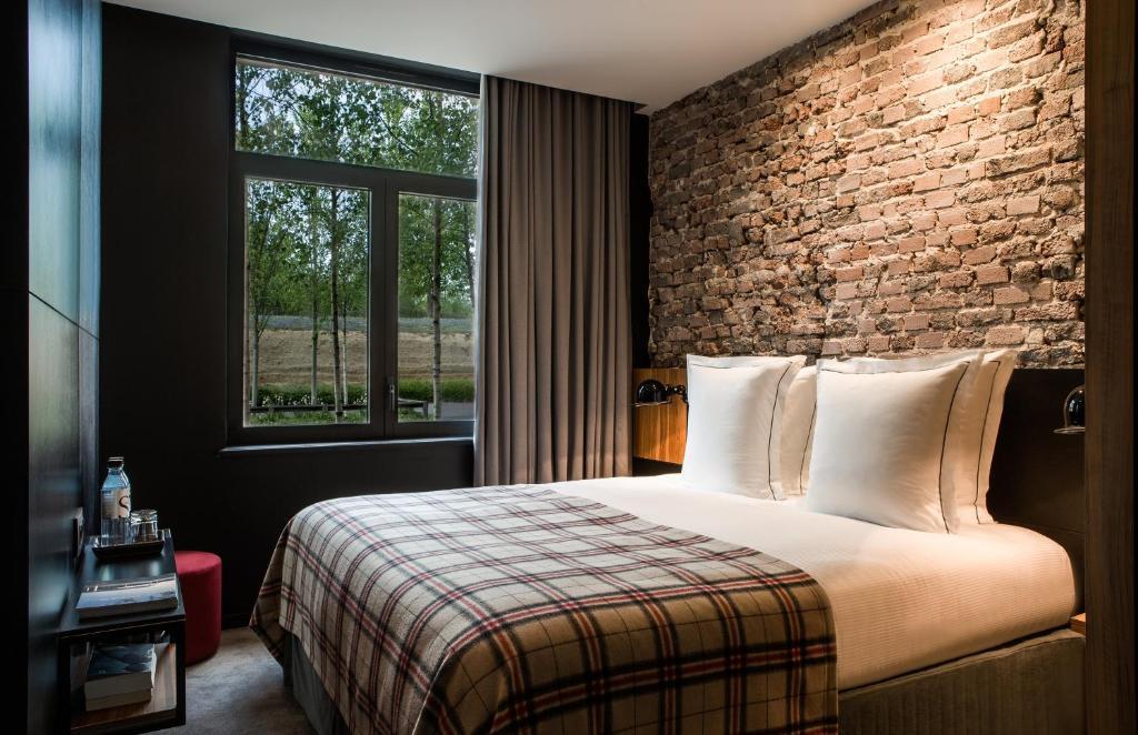 Un ou plusieurs lits dans un hébergement de l'établissement Hotel Louvre Lens - Esprit de France