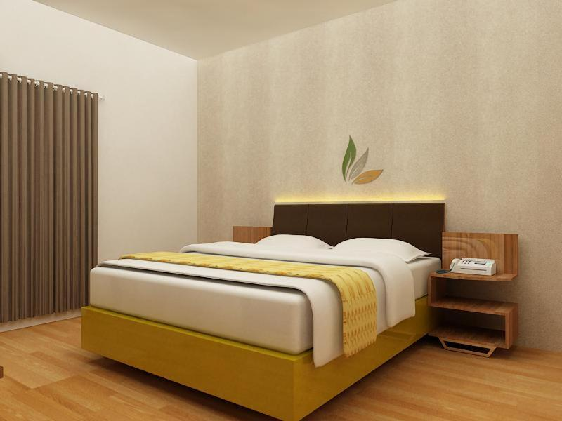 A bed or beds in a room at Hotel Salam Asri