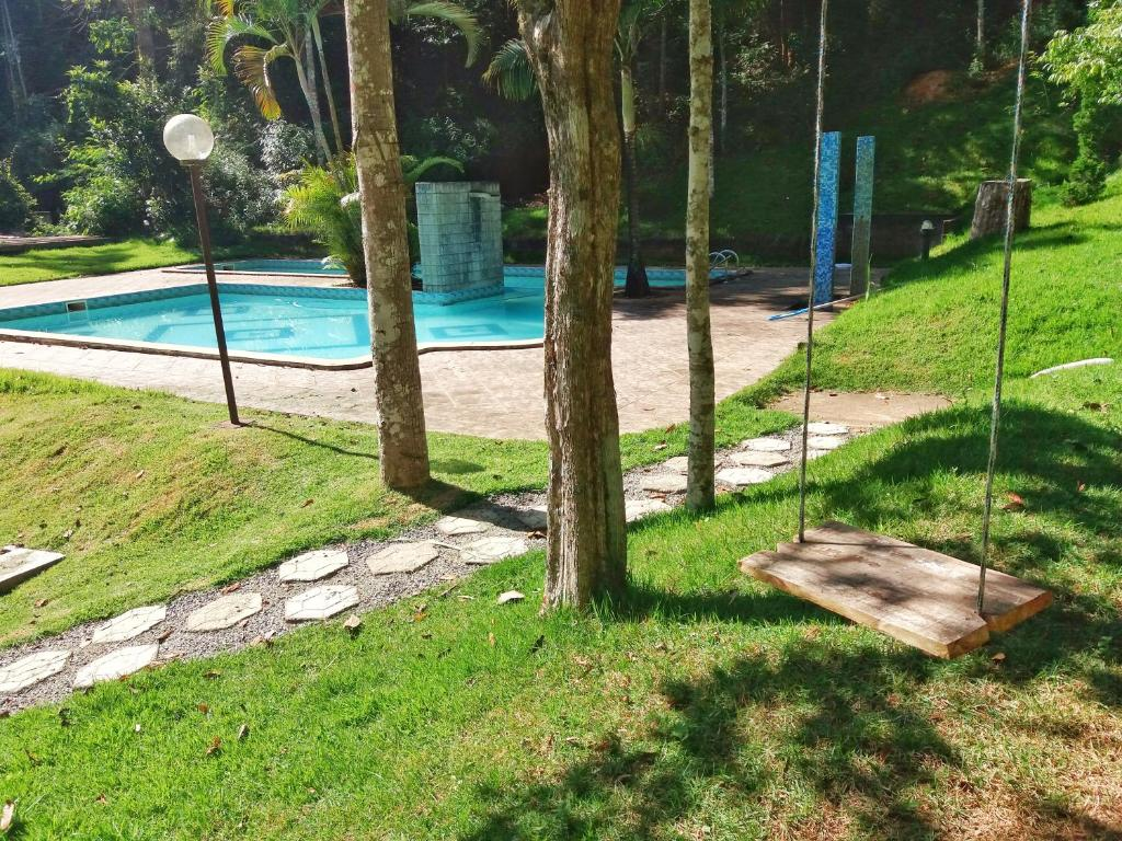 The swimming pool at or near Sitio Flores da Mata