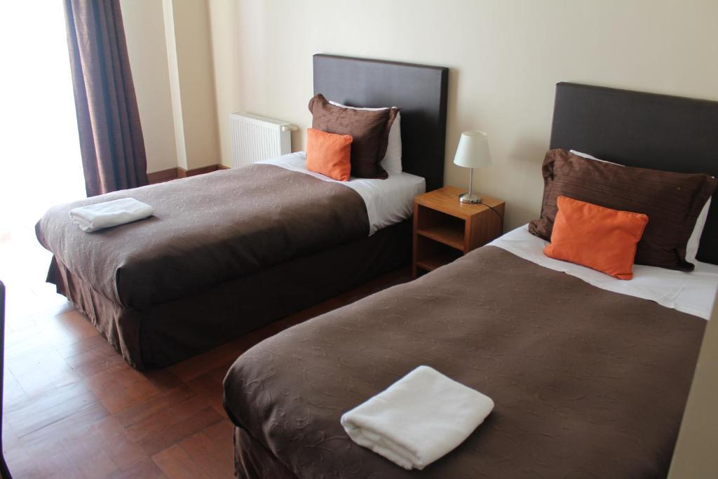 Cama o camas de una habitación en Hotel Rialto