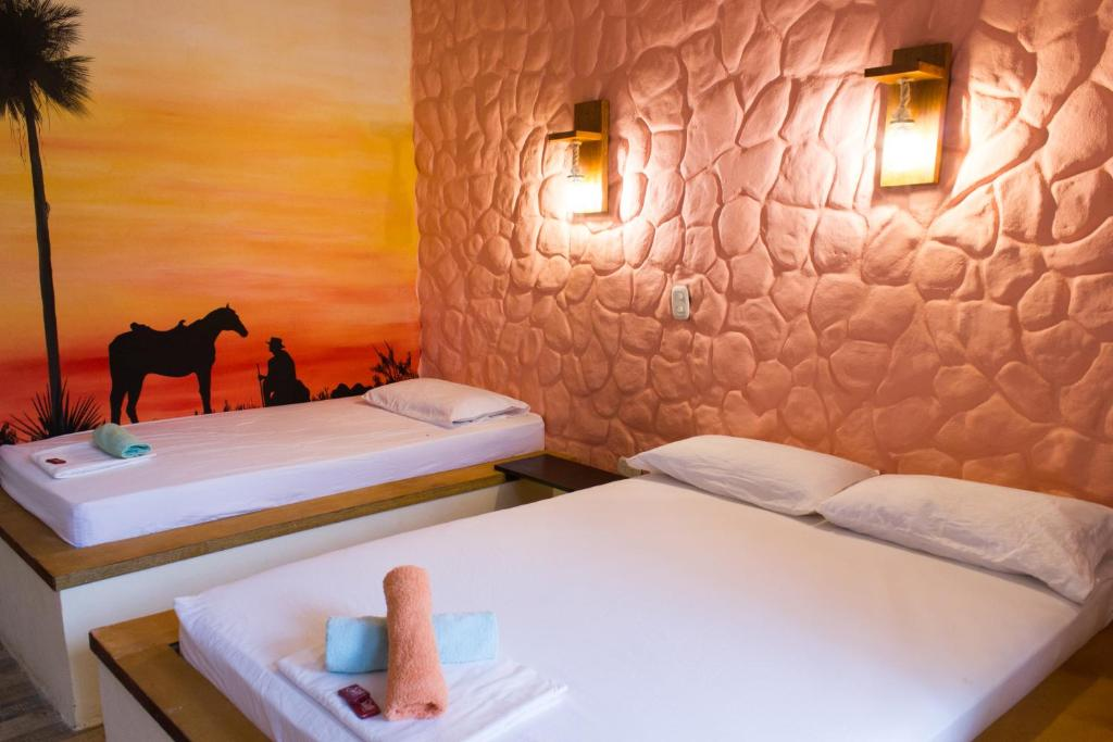 A bed or beds in a room at Nuevo Oeste