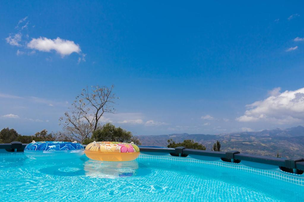 The swimming pool at or near Brisas de Chica