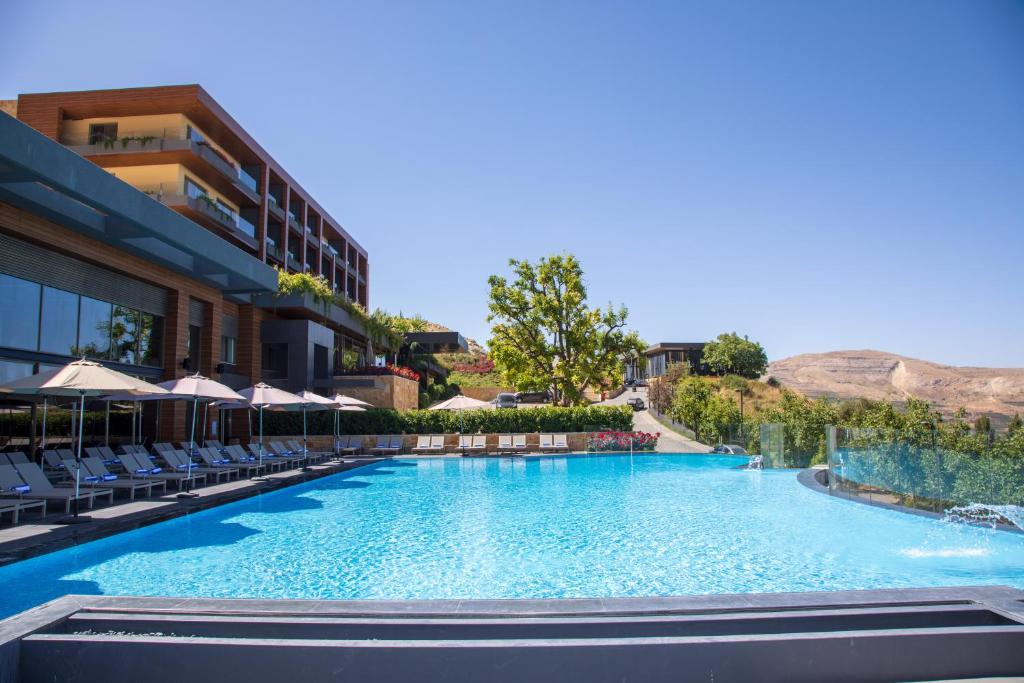 The swimming pool at or near Mist Hotel & Spa by Warwick