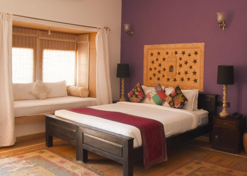 A bed or beds in a room at Jasmin Home