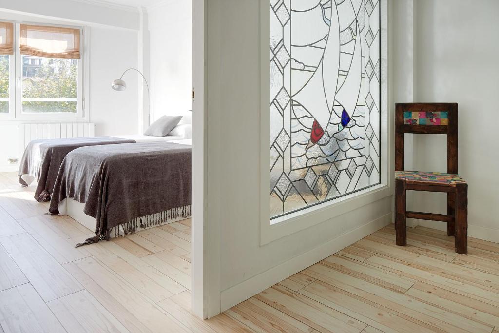 Ein Bett oder Betten in einem Zimmer der Unterkunft Soroa Apartment