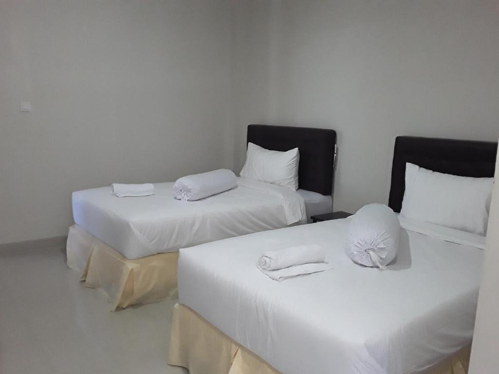 Voodi või voodid majutusasutuse Victory Hotel toas