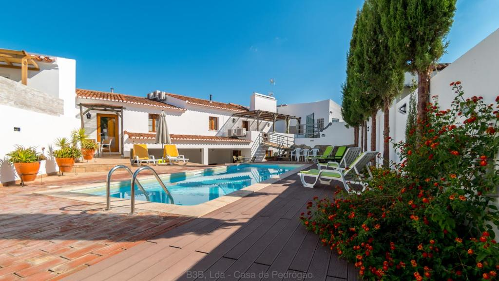 The swimming pool at or near Casa de Pedrogao