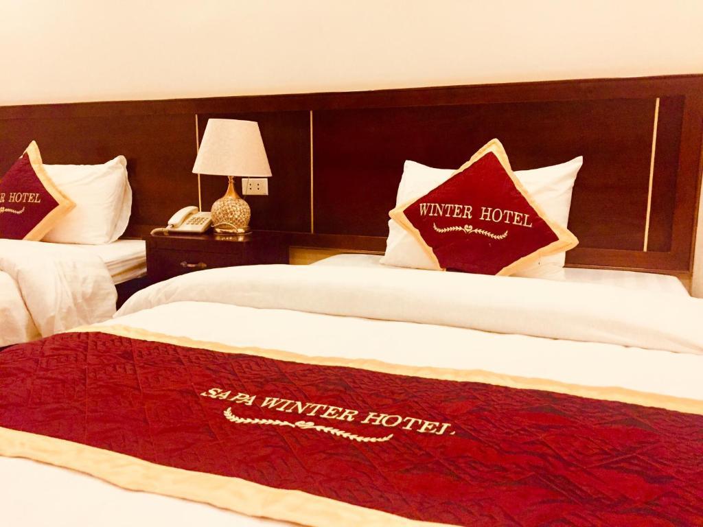 Gulta vai gultas numurā naktsmītnē Sa Pa Winter Hotel
