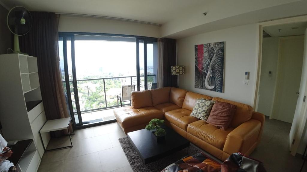 A seating area at Beachfront Seaview/City view on 26th Floor 1 BR 8