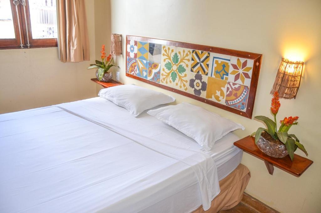 Cama ou camas em um quarto em Pousada Fortal Villa Praia