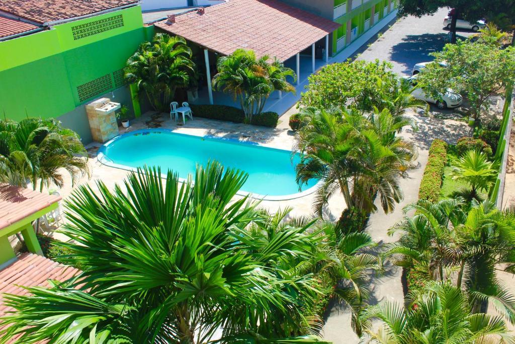 Uma vista da piscina em Pousada o Caribe de Maragogi ou nos arredores