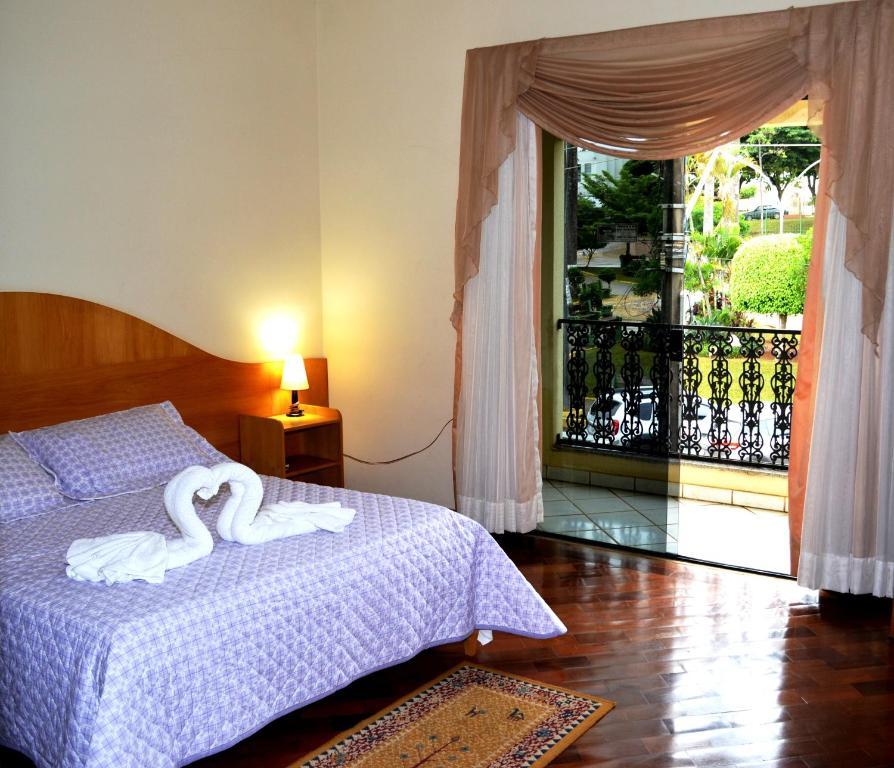 Cama ou camas em um quarto em Hotel da Canastra