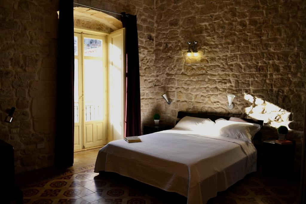 A bed or beds in a room at Palazzo Beau